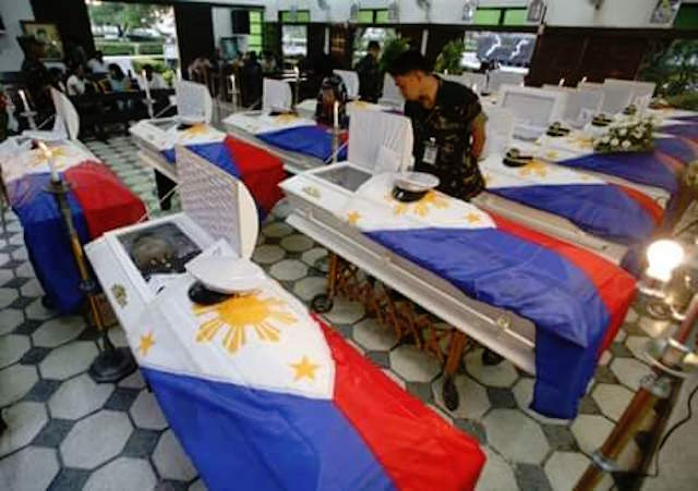 THE FALLEN. Flag-draped coffins containing the bodies of the 18 soldiers killed in an encounter with Abu Sayyaf bandits are pictured at the Western Mindanao Command (Westmincom) headquarters in Zamboanga City, April 10, 2016. Photo via Richard Falcatan