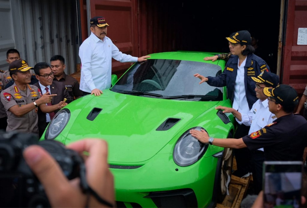 BUSTED. This handout photo taken on December 17, 201 shows Indonesia's Finance Minister Sri Mulyani Indrawati (top right) gesturing next to a seized luxury car during a raid in Jakarta. Handout /Indonesian Finance Ministry/AFP