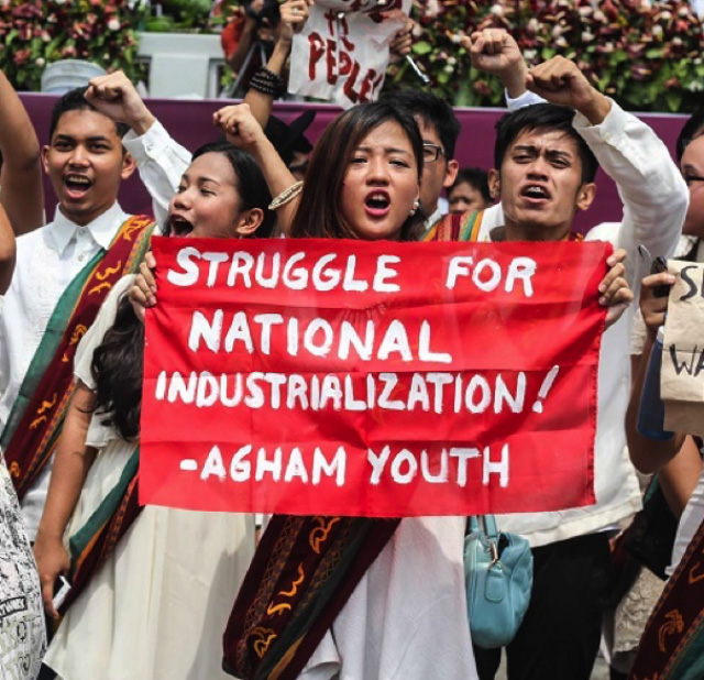 BETTER RESOURCES. A science education graduate holding up a streamer calling for national industrialization during graduation rites in the University of the Philippines - Diliman. Image courtesy of Agham Youth