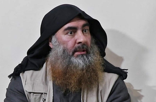 DEAD. In this file photo taken on April 30, 2019 In this undated tv grab taken from a video released by Al-Furqan media, the chief of the Islamic State group Abu Bakr al-Baghdadi purportedly appears for the first time in 5 years in a propaganda video in an undisclosed location. File photo from Al-Furqan Media/AFP