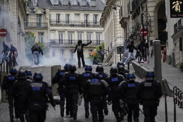 CLASH. Members of the Gendarmerie charge as protestors linked to the Yellow Vests (Gilets Jaunes) movement take part in a demonstration on the side of the annual Bastille Day ceremony, on July 14, 2019, near the Champs-Elysees in Paris.u00c2u00a0Photo by Kenzo Tribouillard/AFP