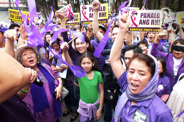 RH WINS. Health advocates celebrate their victory. File photo by Rappler