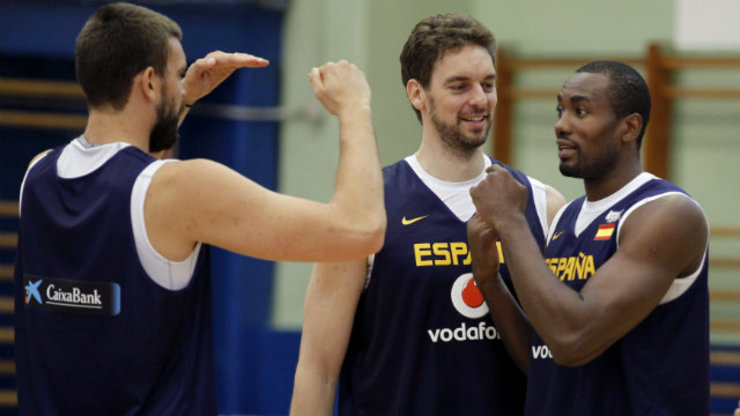 Marc and Pau Gasol (left and center) and Serge Ibaka (R) of Spain will give the defending champions USA a run for their money. Photo by Angel Diaz/EPA