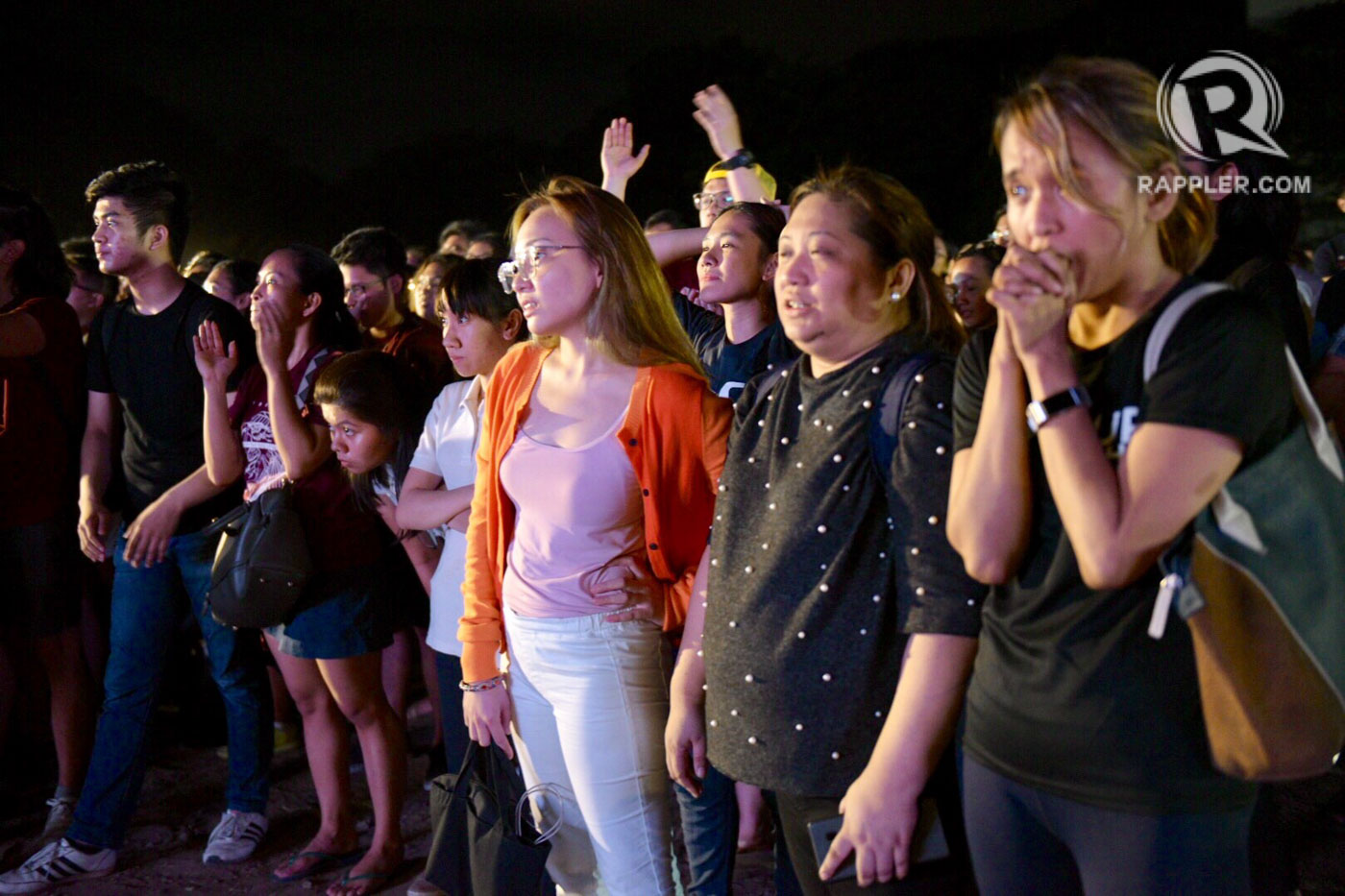 PRAYERS. UP students hope for the best during the final seconds. Photo by Leanne Jazul/Rappler