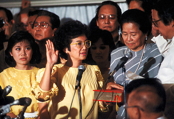 NEW PRESIDENT. President Corazon Aquino takes her oath as president, marking the culmination of the 4-day People Power Revolution in 1986. Photo from Official Gazette