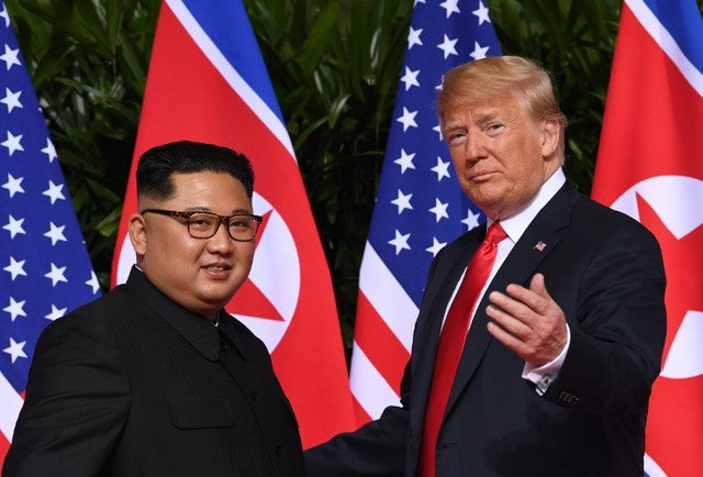WISHES. US President Donald Trump meets with North Korea's leader Kim Jong-un at the start of their historic US-North Korea summit, at the Capella Hotel on Sentosa island in Singapore on June 12, 2018. Photo by Saul Loeb/AFP
