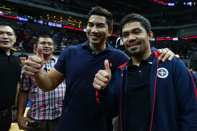 UAAP BOUND. Aldin Ayo (L) poses with boxing champion and Letran team manager Manny Pacquiao smile after winning the NCAA title. Ayo will try to replicate his rookie coach success in the UAAP. File photo by Josh Albelda/Rappler