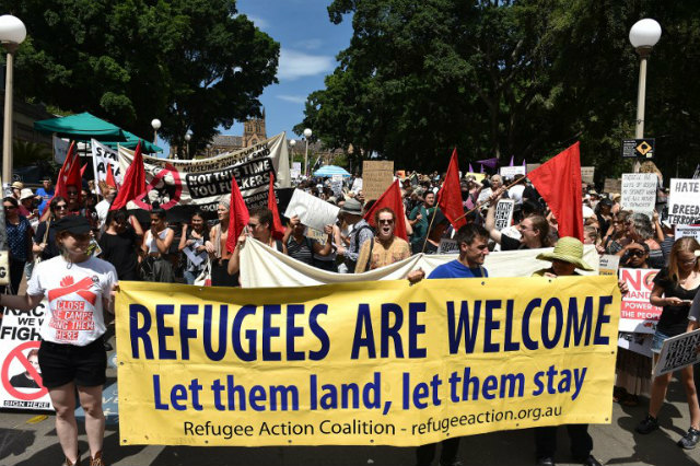 WELCOME. Protestors march on the streets of Sydney's central business district in support of refugees. File photo by Saeed Khan/AFP