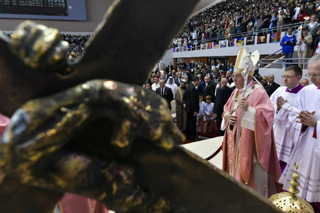 POPE VISITS. This photo taken and handout by the Vatican press office, Vatican Media, on March 31, 2019 shows Pope Francis (R) celebrating a mass at the Prince Moulay Abdellah Sports Centre in the Moroccan capital Rabat. Handout photo by Vatican Media/AFP