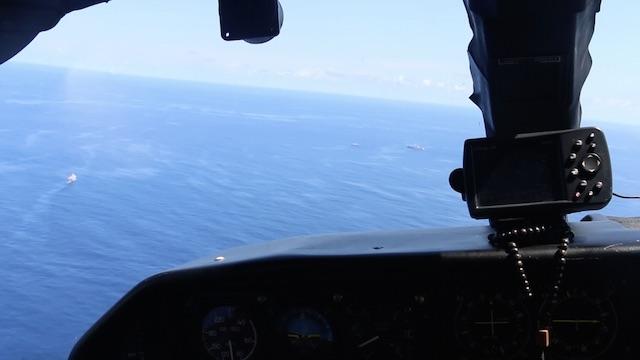 OVERFLIGHT. A Coast Guard islander plane accompanies deployment of Coast Guard ships to Scarborough Shoal