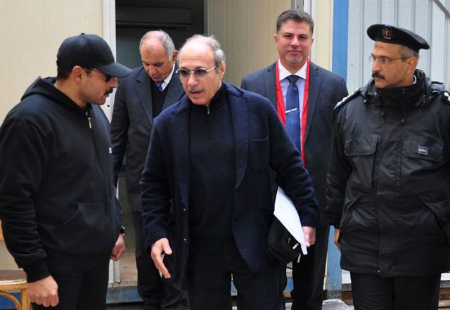 UNFREEZE. Egyptian former interior minister Habib al-Adly (C) walks outside the court room after his retrial at Cairo's police academy on February 24, 2015. File photo by AFP/STR