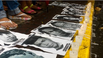 NEVER AGAIN. Photos of human rights victims during the Martial Law. Photo by Patty Pasion/Rappler