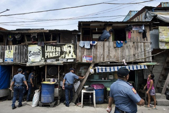 TOKHANG. Police implement Oplan Tokhang, a literal door-to-door, knock-and-plead operation that targets suspected drug users and pushers. It aims to curb demand. File photo by Noel Celis/AFP