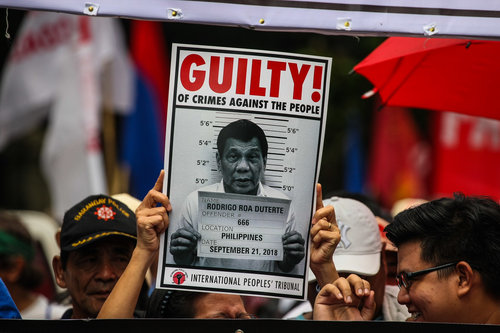 PROTESTS PUSH THROUGH. For the Martial Law anniversary on September 21, 2018, activist groups carry a photo of President Rodrigo Duterte, whom the International People's Tribunal declared guilty of crimes against humanity. Photo by Maria Tan/Rappler