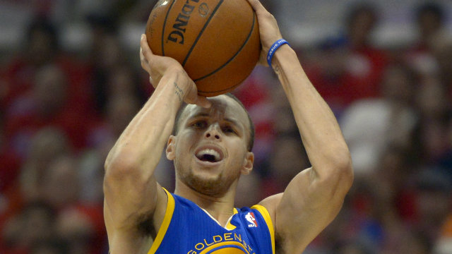 SPLASH! Early NBA MVP Candidate Stephen Curry goes up for a shot. Photo by Paul Buck/EPA