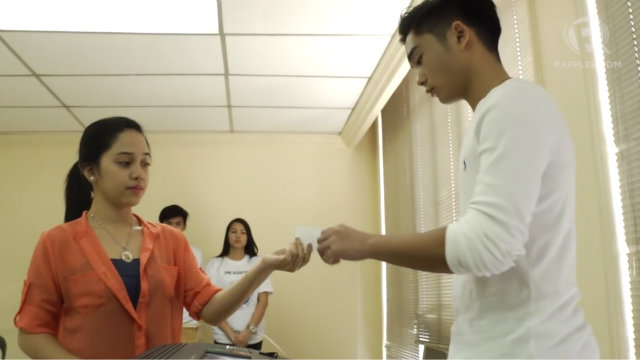 HANDING OVER. Make sure you do not see the contents of the voter's receipt when you hand it over to the voter. Rappler photo