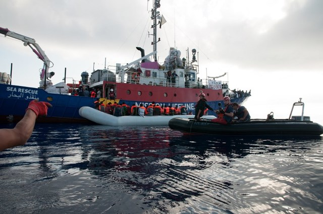 MIGRANTS. This handout picture obtained on June 22, 2018 from the German NGO 'Mission Lifeline' shows migrants on an inflatable boat boarding the Lifeline sea rescue boat at sea on June 21, 2018. Photo by Hermine Poschmann/Mission Lifeline/AFP