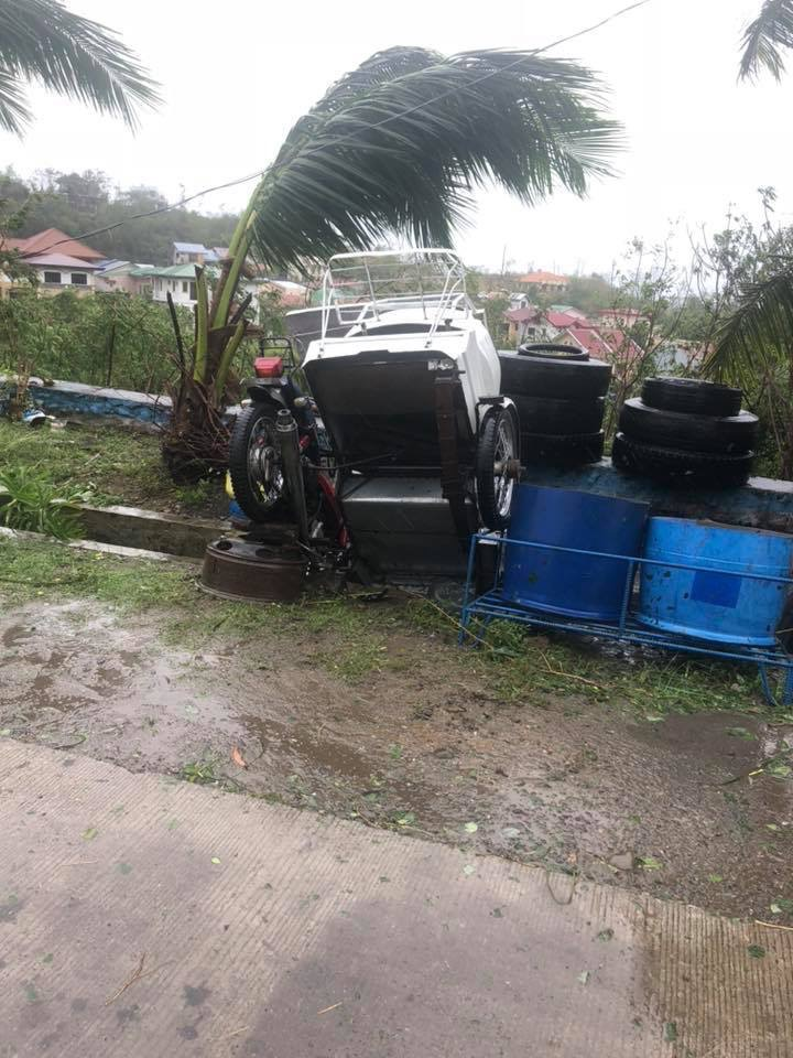 UPSIDE DOWN. A tricycle in Ilagan City was no match for Typhoon Rosita. Photo by Fr Grevie Uanan