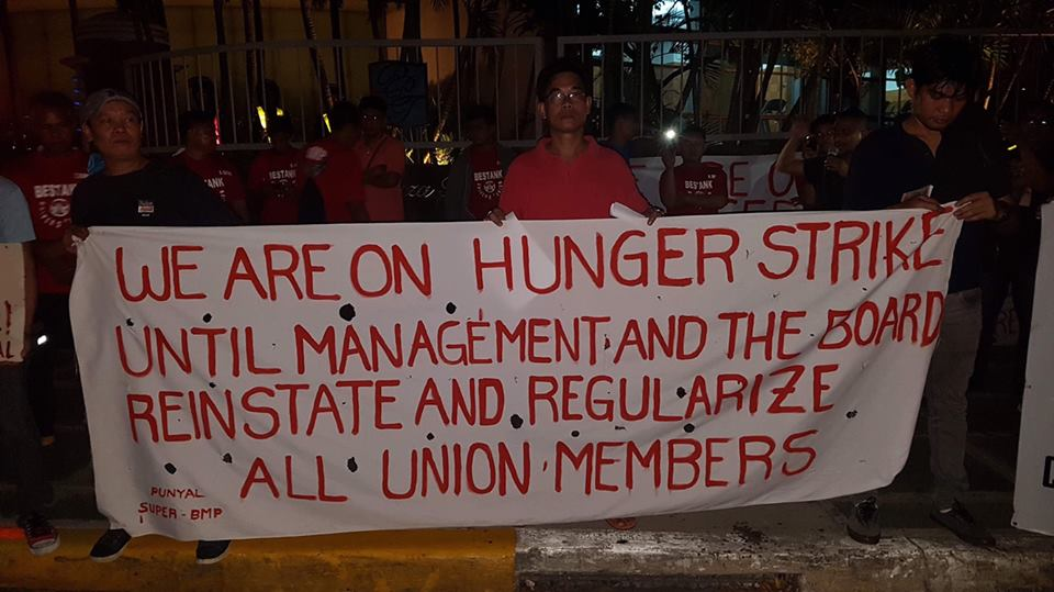 HUNGER STRIKE. Workers hold a banner outside Pacific Plaza Towers where they are conducting a hunger strike. Photo from SUPER-BMP