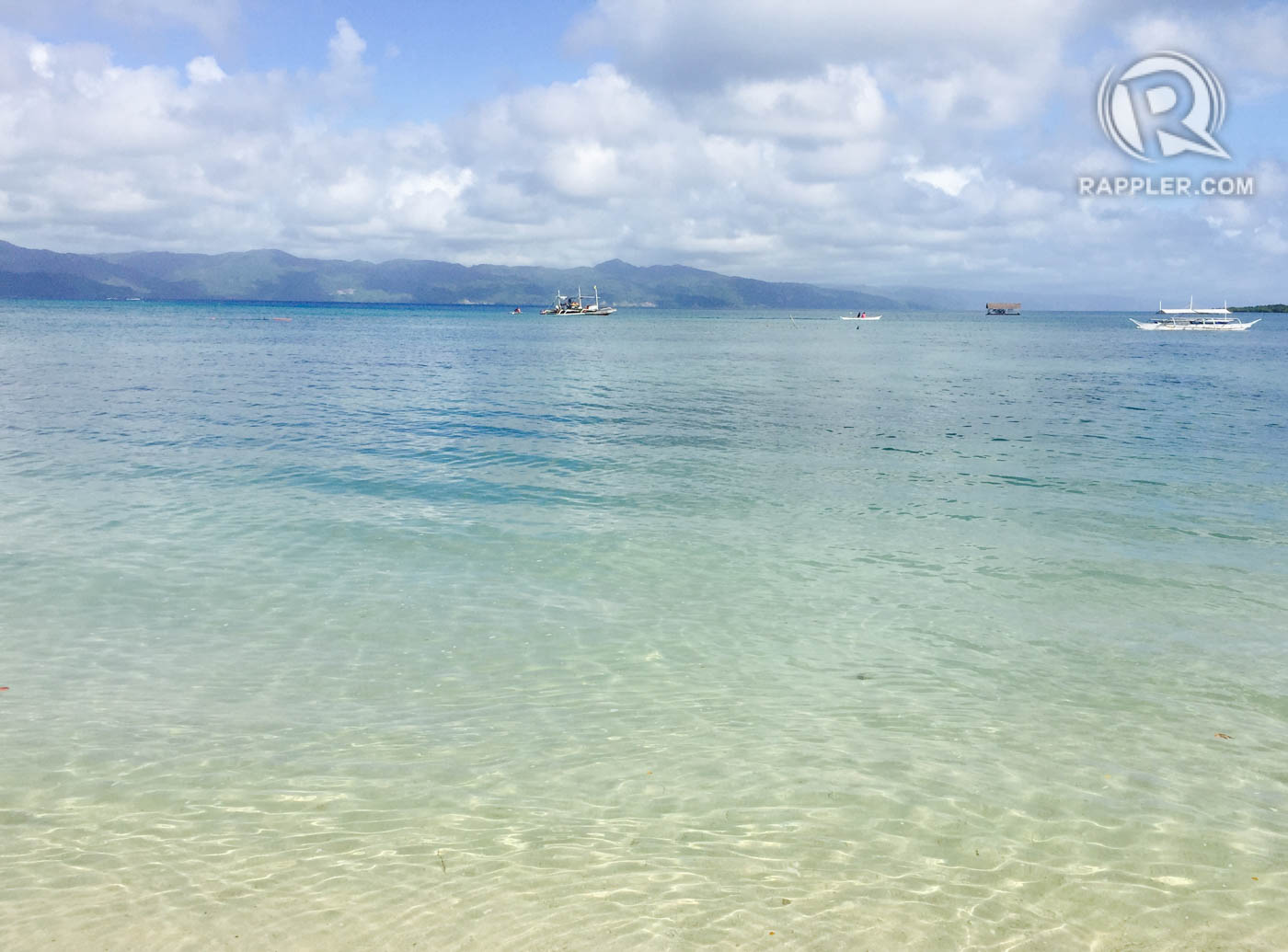 CRYSTAL CLEAR. The island's pristine waters. Photo by Bonz Magsambol/Rappler