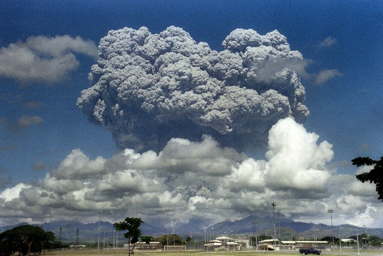 ERUPTION. A giant volcanic mushroom cloud explodes some 20 kilometers high from Mount Pinatubo above almost deserted US Clark Air Base, on June 12, 1991 followed by another more powerful explosion. File photo by Arlan Naeg/AFP