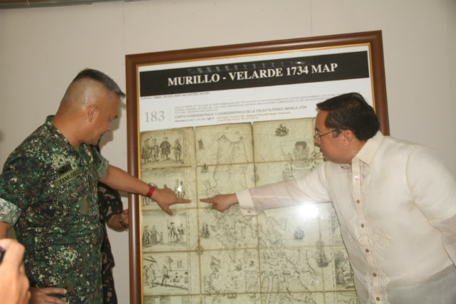 'SCARBOROUGH IS OURS.' The Northern Luzon Command on June 6, 2016, receives a framed replica of the 1734 Murillo Map that shows the disputed Panatag Shoal (Scarborough Shoal) as part of the Philippines. Photo courtesy of Northern Luzon Command