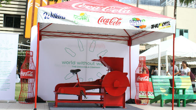 COKE TUNE-CYCLE. The Coke Tune-Cycle shreds PET bottles which will be used to create eco-bricks.
