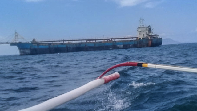 DREDGING. Philippine Coast Guard personnel inspect the dredging vessel docked in Lobo, Batangas. Photo from PCG Batangas