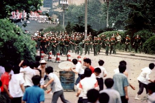 CLASHES. Chinese citizens and students of Chengdu, capital of Sichuan province, hurl stones at troop on June 4, 1989 during a rioting following the proclamation of the martial in the city. File photo by AFP