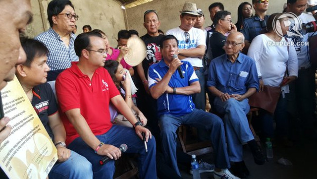 DIALOGUE WITH FARMERS. Duterte and Cayetano meet with Quezon coconut farmers and coco levy fund advocate Oscar Santos (right, seated). Photo by Pia Ranada/Rappler
