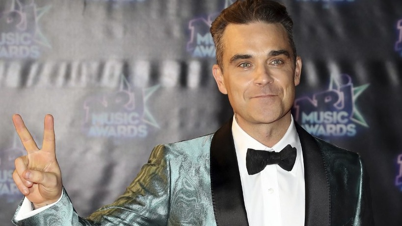 UK RECORD. British singer Robbie Williams and Elvis Presley share the record for the most UK number one solo albums. Photo by Valery Hache/AFP