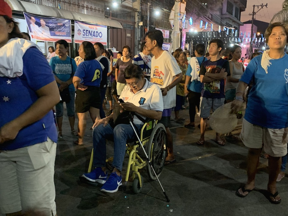 SUPPORTER. A Duterte supporter attends the Malabon rally in a wheelchair. Photo by Camille Elemia/Rappler