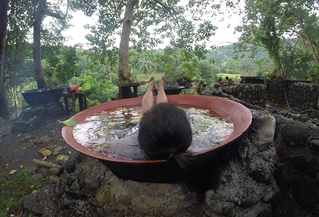 UNWIND. Narl takes a relaxing dip in a giant kawali in Antique
