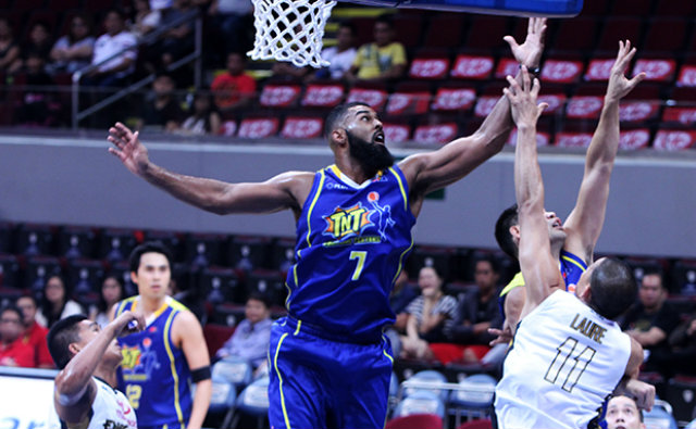 TEXT BLAST. Talk 'N Text rookie Moala Tautuaa goes up for a rebound as the Texters rebound from their opening loss. Photo by PBA Images