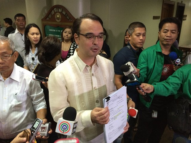 'LIKE ADULTERY.' Senator Alan Peter Cayetano holds up documents that, he says, establish the MILF's ties with Marwan. File photo by Ayee Macaraig/Rappler