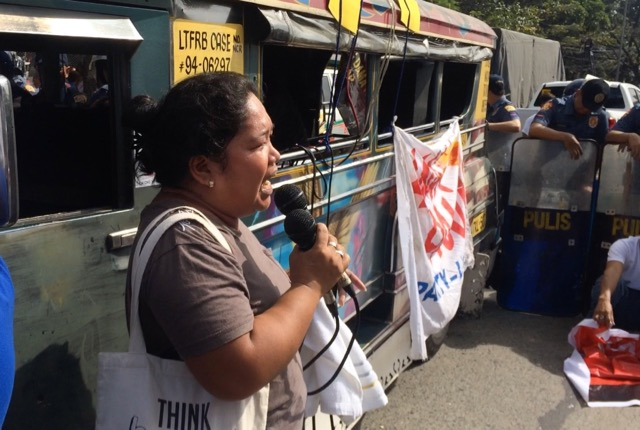 SEEKING AID. Housewife and urban poor leader Stella Poblete airs her community's plight in a rally in front of the National Housing Authority. Photo by Patty Pasion/Rappler