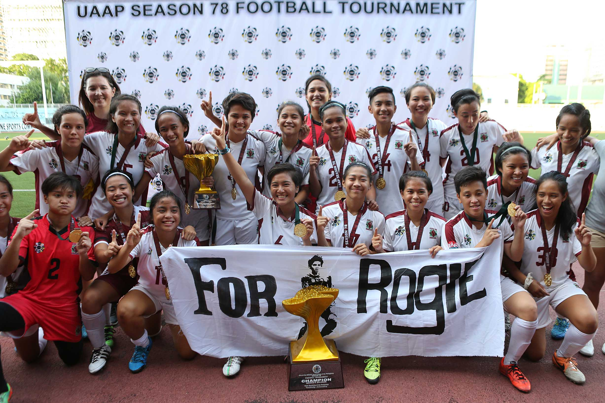 FOR ROGIE. The UP women's football team gives respect for Rogie Maglinas, the UP men's player who died earlier this year from cancer, after winning its first ever UAAP women's football title. File photo by Josh Albelda/ Rappler