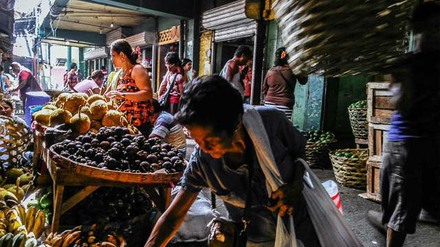 MARKETPLACE. Locals pick out fruits at a market in Cebu. Photo by Hannah Reyes