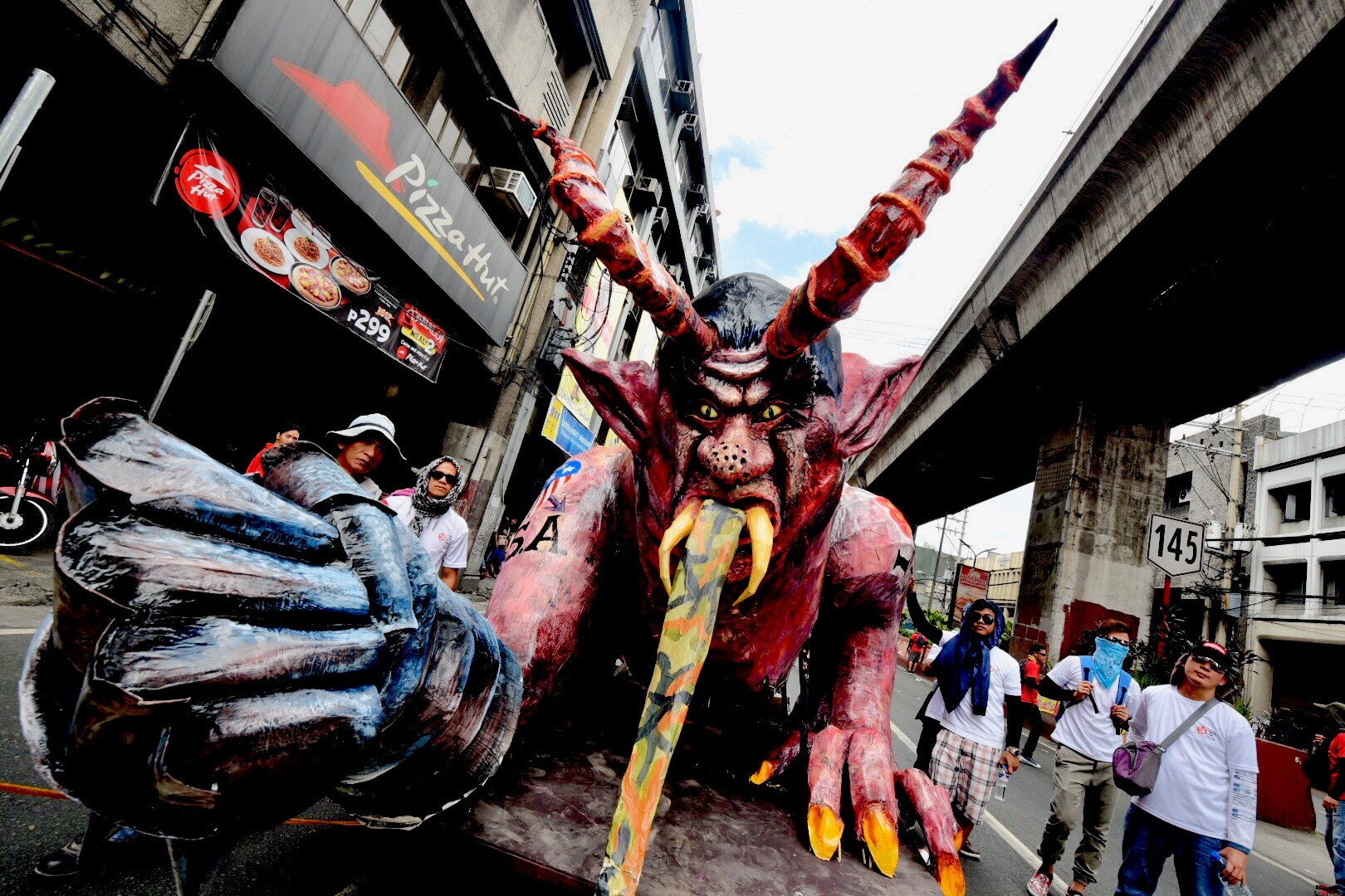 BURN. Called u0022Dutertemonyo,u0022 an effigy depicting the face of Duterte as a demon was later burned during the demonstration. Photo by Alecs Ongcal/Rappler