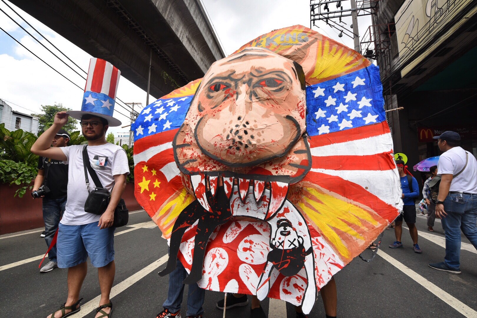 EFFIGY. On the way to Mendiola, an effigy depicting Duterte eating a Filipino is being pushed by protesters during the rally. Photo by Alecs Ongcal/Rappler