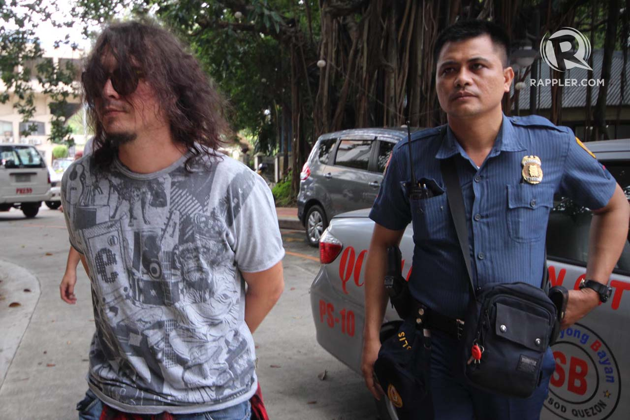 Baron Geisler is escorted by a policeman for inquest at the Quezon City fiscal office on Tuesday, after he was arrested on Monday night, by members of the Quezon City Police District's Station 10 along Kamuning Road. Photo by Darren Langit/Rappler
