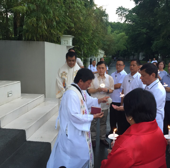 BLESS THIS HOUSE. President Rodrigo Duterte is joined by some staff members at his house blessing. Photo from Special Assistant to the President Bong Go