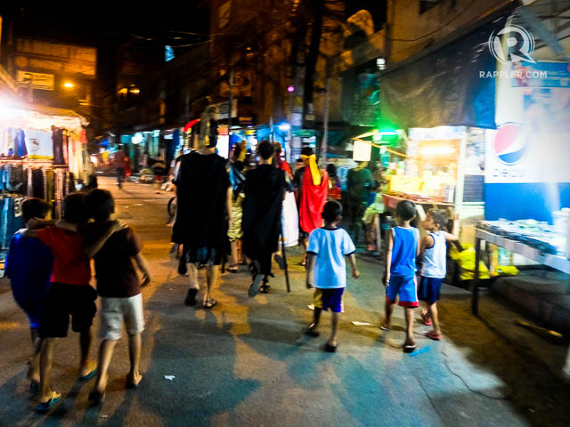 DOWN THE STREET. A group of u2018Roman Soldiersu2019 walk through the local market towards the parish church to collect the image of their Patron Saint San Juan Nepomuceno. All photos by Shirin Bhandari