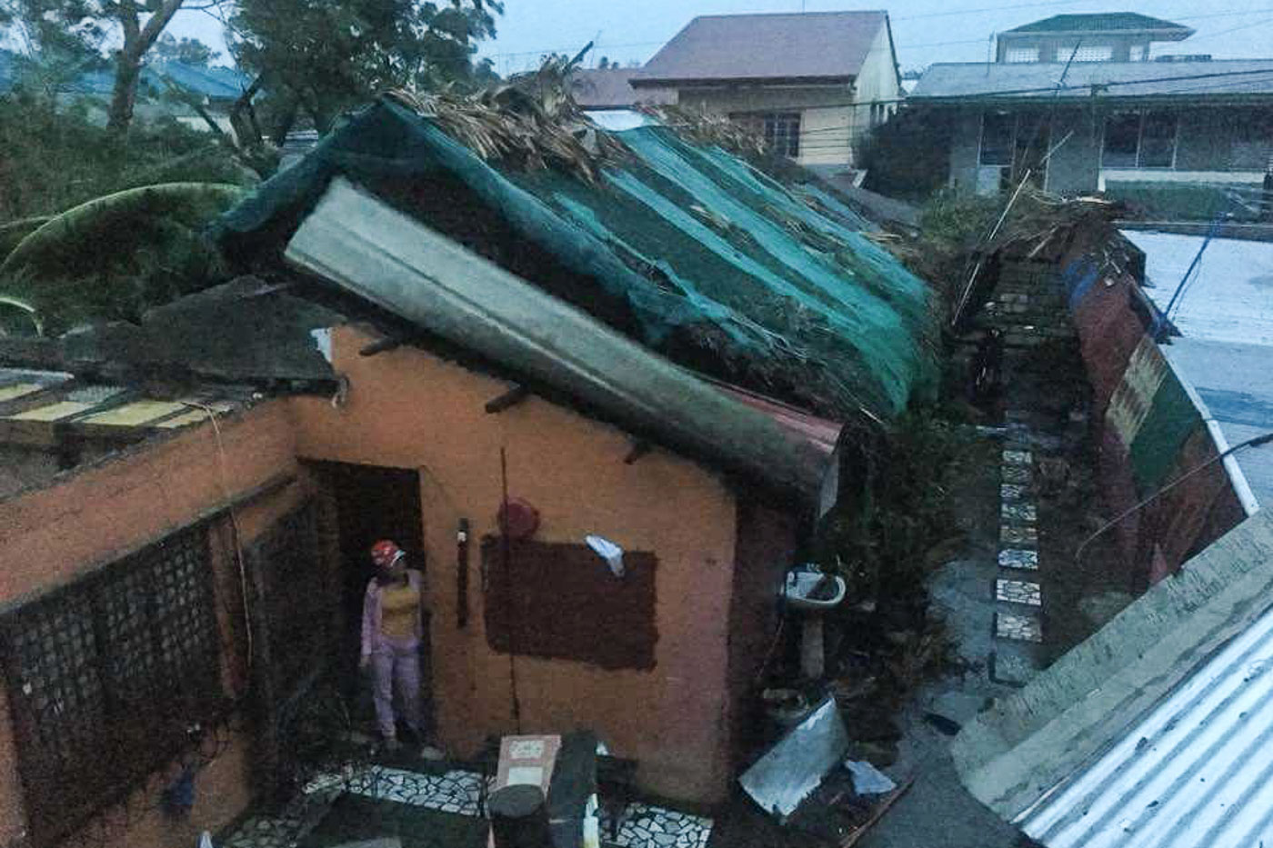 BLOWN OFF. Strong winds rip roofs off houses in Laoag City, Ilocos Norte. Photo by MJ Valiente Valdez