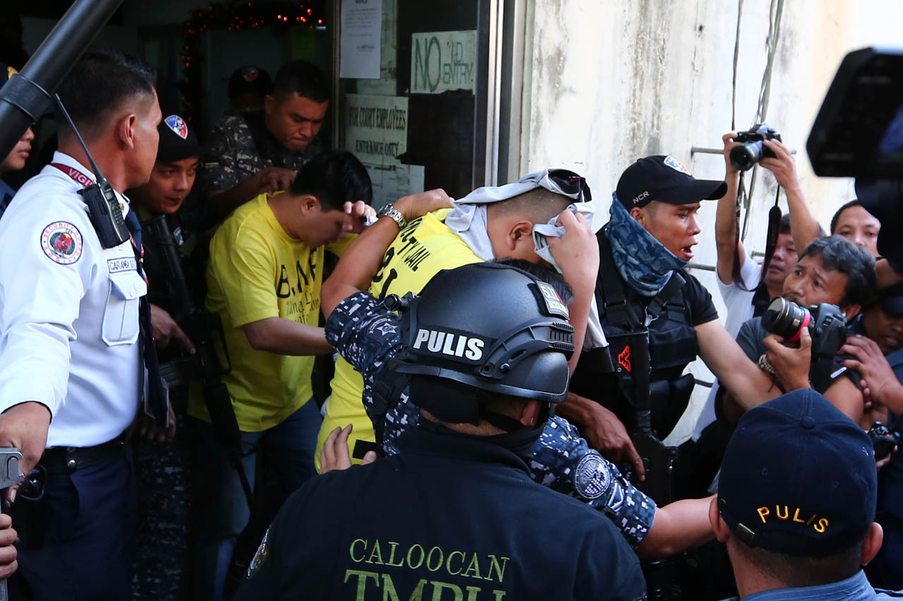CONVICTS. PO1 Jeremias Pereda (front in yellow) and PO1 Jerwin Cruz (back in yellow) are convicted of murder for the killing of 17-year-old Kian delos Santos. Photo by Jire Carreon/Rappler