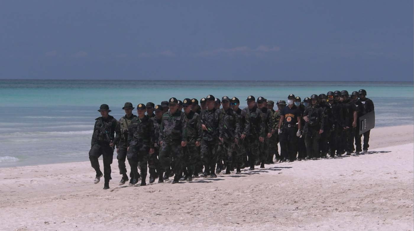 SOLDIERS IN THE BEACH. Soldiers simulate a terror attack and hostage-taking on the beaches of Boracay Island. Photo by Adrian Portugal/Rappler