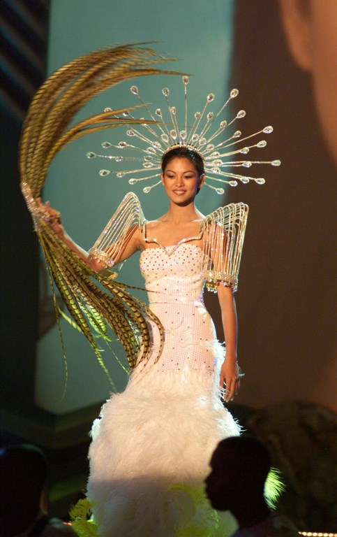 PHILIPPINES' PRIDE.  Miss Philippines Miriam Quiambao walks across the stage during pre-taping of the National Costume portion of the Miss Universe competition on May 23  May 1999 in Chaguaraamas, Trinidad and Tobago.  File photo by Miss Universe Organization/AFP
