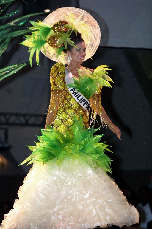 PINEAPPLE DRESS. Carla Gay Balingit, Miss Philippines 2003, wears a typical fantasy dress during the Miss Universe 2003 competition, in Panama City on May 26, 2003.  File photo Teresita Chavarria/AFP