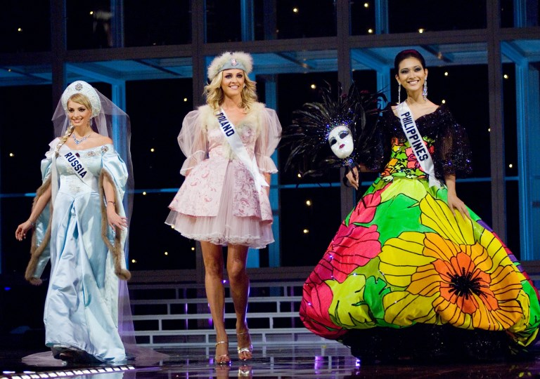 MASKARA. Miss Russia Tatiana Kotova, Miss Poland Dorota Gawron, and Miss Philippines Anna Theresa Licaros pre-tape their introductions for the 2007 Miss Universe pageant in their national costumes at the Auditorio Nacional in Mexico City on May 24, 2007.  File photo by Darren Decker/ Miss Universe Organization/AFP