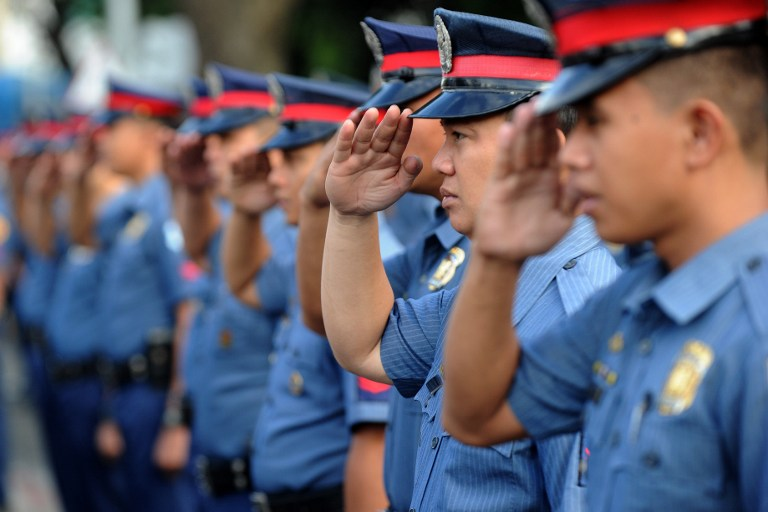 PHILIPPINE POLICE. The PNP-ACG is the unit under the Philippine police tasked with fighting cybercrime. File photo by Jay Directo/AFP
